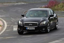 Sebastian Vettel drives an Infiniti M on the Nordschleife circuit