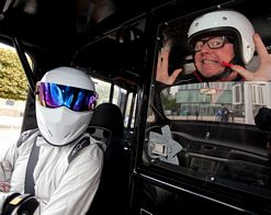 The Stig and Chris Evans with a Black Cab